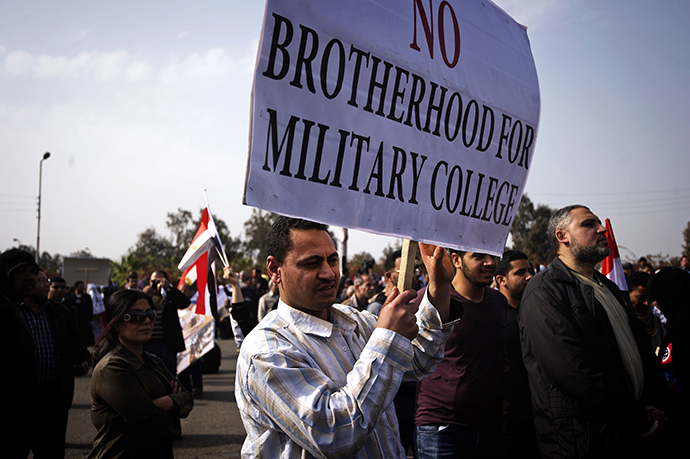 An Egyptian protester holds a sign during a demonstration against the Muslim Brotherhood in Cairo on March 1, 2013. (AFP Photo / Gianluigi Guercia)