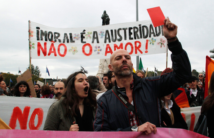 Demostrators shout while taking part in a march against government austerity policies in Lisbon March 2, 2013 (Reuters / Hugo Correia)
