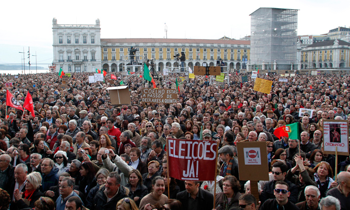 People gather to protest against government austerity policies at Lisbon's main square Praca do Comercio March 2, 2013 (Reuters / Hugo Correia)