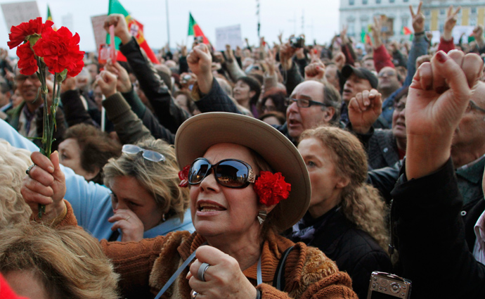 People shout slogans as they take part in a protest against government austerity policies at Lisbon's main square Praca do Comercio March 2, 2013 (Reuters / Hugo Correia)
