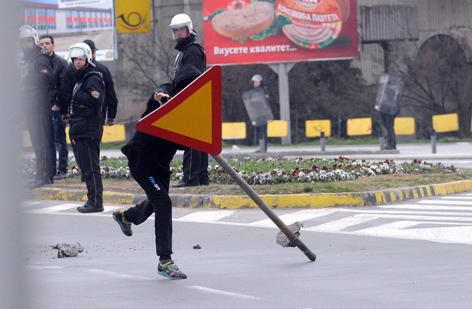 An Ethnic Albanian carry a road sign during clashes with Macedonian riot police in Skopje on March 2, 2013 (AFP Photo / Robert Atanasovski)
