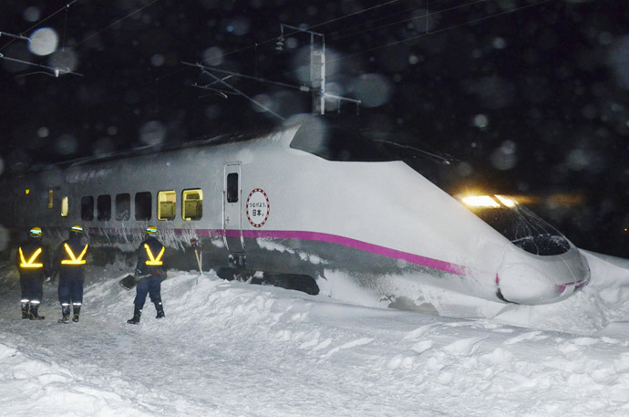 Derailed Akita Shinkansen train is seen in Daisen, Akita prefecture, in this photo taken by Kyodo March 2, 2013. (Reuters/Kyodo)