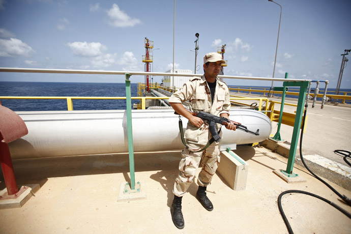 An anti-Gaddafi fighter stands guard at the Mellitah Oil and Gas complex during a handover ceremony in Mellitah, 80 km west Tripoli September 6, 2011. (Reuters/Zohra Bensemra)