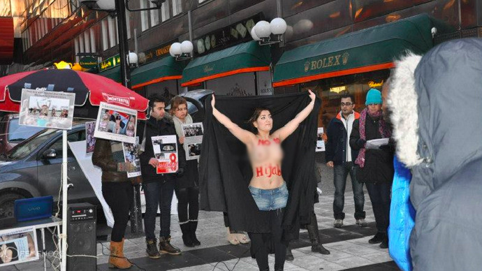 Female Iranian Communists Organize Topless Protest Against -1600