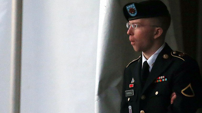 Pfc. Bradley E. Manning is escorted from a hearing, on January 8, 2013 in Fort Meade, Maryland. (AFP Photo / Mark Wilson)