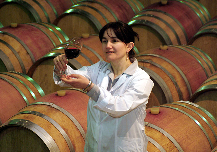 A Georgian specialist holds up a glass of wine at a vineyard in Telavi in eastern Georgia. (Reuters)