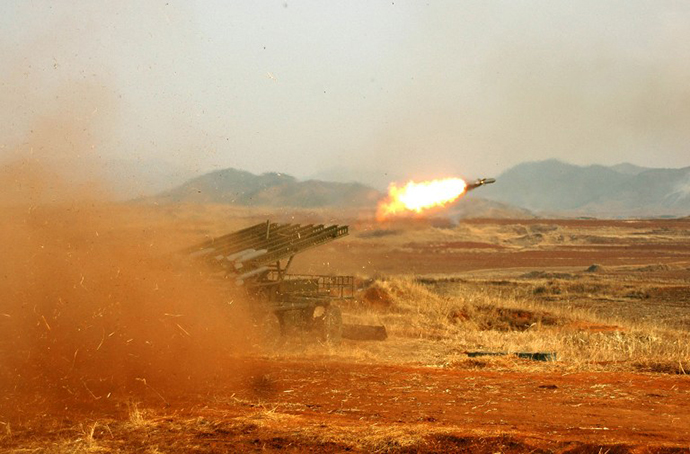 This undated photo released by North Korea's official Korean Central News Agency (KCNA) via the Korean News Service (KNS) on February 26, 2013 shows an artillery firing drill of Korean People's Army. (AFP Photo / KCNA)
