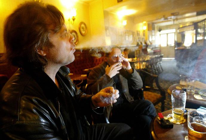 A smoker exhales in a pub in Richmond, London. (AFP Photo / Carl de Souza)