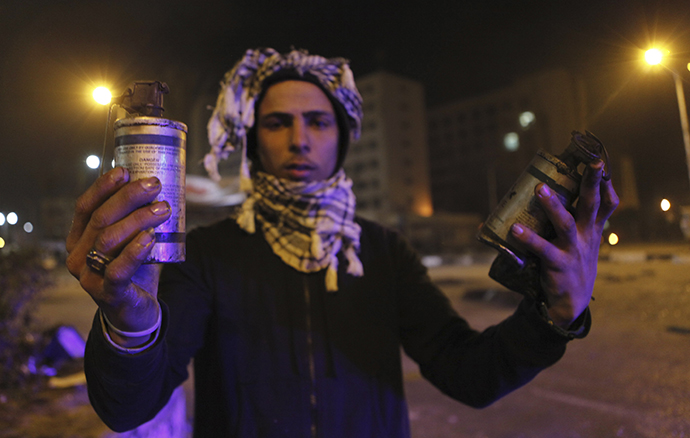 A protester, who opposes Egyptian President Mohamed Mursi, shows empty teargas canisters during clashes with riot police in front of Security Directorate of Port Said after protesters started to set fire to it in Port Said city, 170 km (106 miles) northeast of Cairo March 5, 2013. (Reuters / Amr Dalsh)