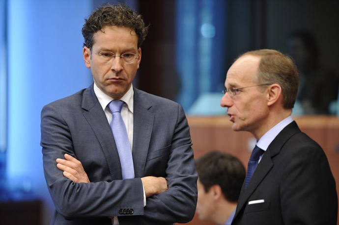 Dutch Finance Minister and Eurozone President Jeroen Dijsselbloem (left) talks with Luxembourg Finance Minister Luc Frieden prior to an Eurozone meeting on March 4, 2013 at the EU Headquarters in Brussels. (AFP Photo / Georges Gobet)