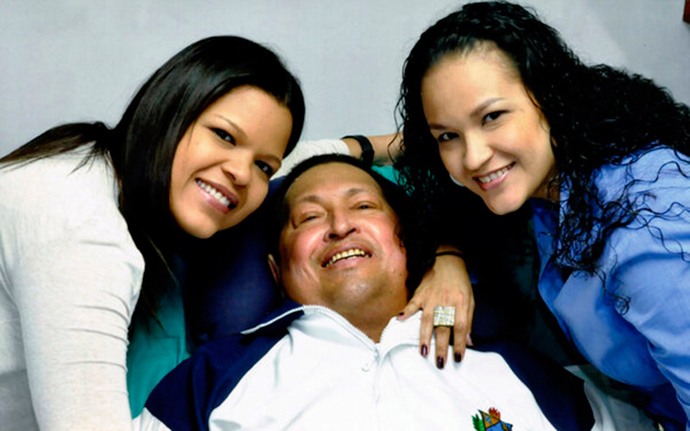 Venezuela's President Hugo Chavez smiles in between his daughters, Rosa Virginia (R) and Maria while recovering from cancer surgery in Havana on February 15, 2013 (Reuters / Ministry of Information / Handout)