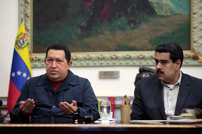 Venezuala's President Hugo Chavez gesturing as he sits next to Vice presidente Nicolas Maduro during a televised radio event in Caracas on 8 December, 2012. (AFP Photo / Presedencia)