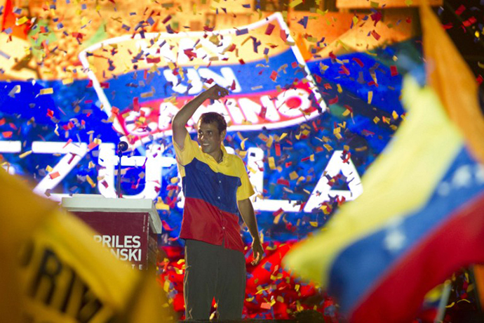 Venezuelan opposition presidential candidate Henrique Capriles reacts at the end of his closing campaign rally in Barquisimento, Lara state, Venezuela, on October 4, 2012. (AFP Photo / Eitan Abramovich)