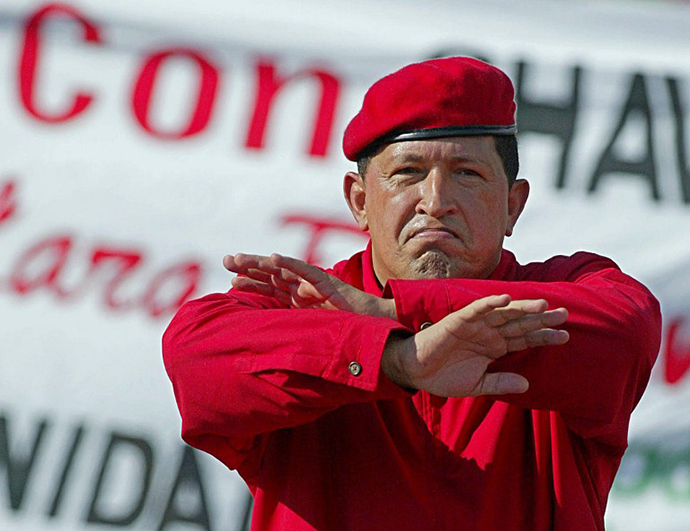 Venezuelan President Hugo Chavez gestures during a demonstration in Caracas 23 August 2003, celebrating his second three-year government (2000-2006). (AFP Photo / Juan Barreto)
