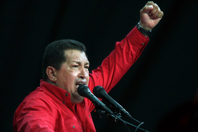 Venezuela's President Hugo Chavez raises his fist as he delivers a speech during a rally in Caracas on November 18, 2008. (AFP Photo / Thomas Coex)