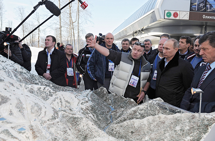 President Vladimir Putin, second right, being shown a model of the Olympic village, snowboarding park, Extreme freestyle center and the Rosa Khutor ski center on February 6, 2013. (RIA Novosti / Alexey Druginyn). ()
