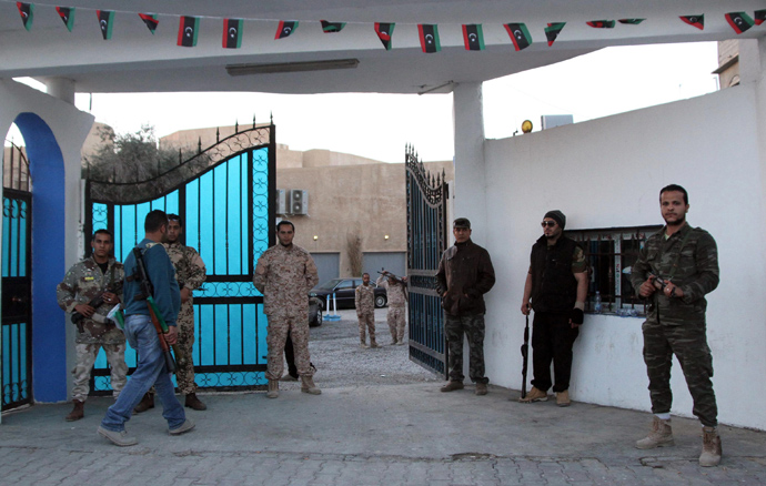 Libyan security forces stand guard outside Alassema television station in Tripoli on March 7, 2013 (AFP Photo / Mahmud Turkia)