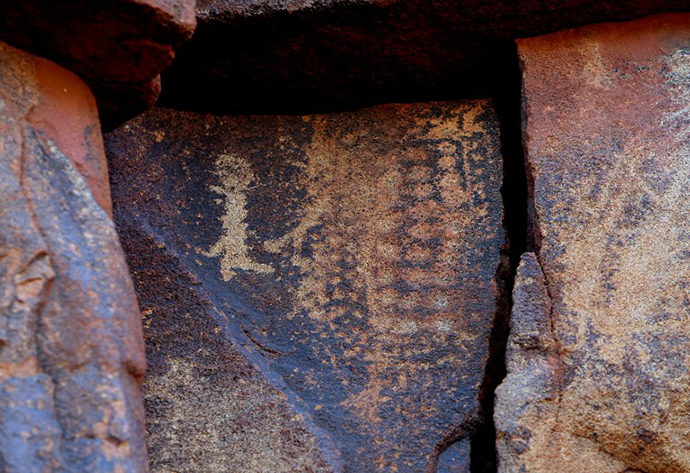 Ancient Aboriginal rock carvings are shown in this photo taken on the Burrup Peninsula in the north of Western Australia. (AFP Photo / Greg Wood)