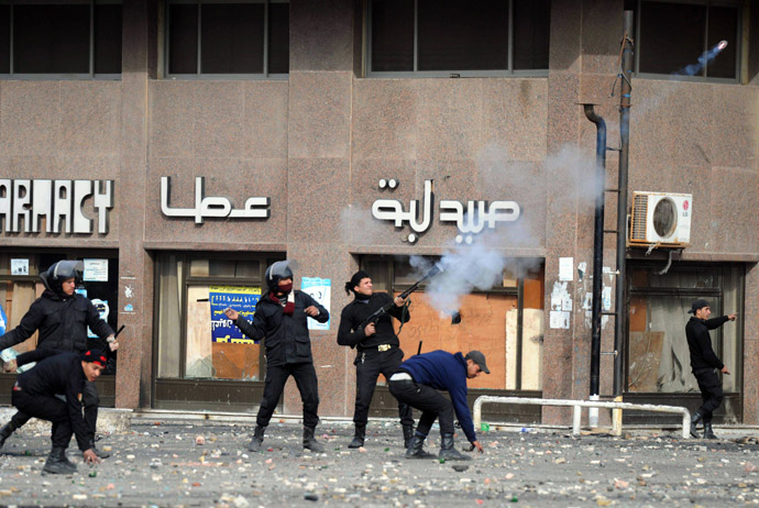 A member of the Egyptian riot police shoots tear gas at protesters during clashes in the Suez Canal city of Port Said on March 7, 2013. (AFP Photo/Jonathan Rashad)
