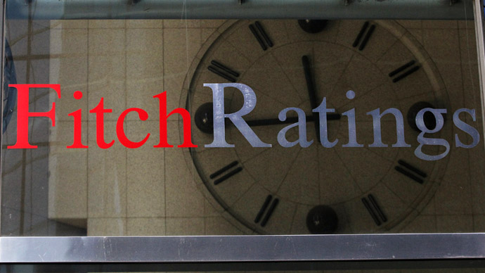 Fitch downgrades Italy, outlook negative
