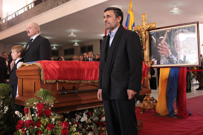 This handout picture released by Venezuelan presidency press office shows Iranian President Mahmoud Ahmadinejad(R) and Belarus President Aleksandr Lukashenko paying their respects at the coffin of late Venezuelan President Hugo Chavez in Caracas, on March 8, 2013. (AFP Photo/Presidencia/Miguel Angel Angulo)