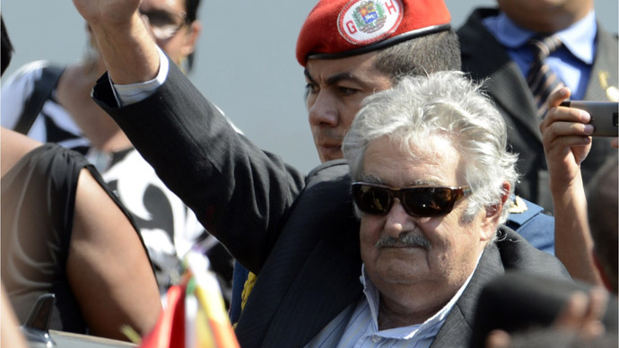 Uruguay's President Jose Mujica waves during the funeral of Venezuela's President Hugo Chavez in Caracas, on March 8, 2013. (AFP Photo/Juan Barreto)