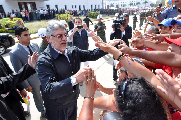 Former Paraguayan President Fernando Lugo arrives to pay his respects to deceased Venezuelan President Hugo Chavez, in Caracas, on March 8, 2013. (AFP Photo/Luis Camacho)