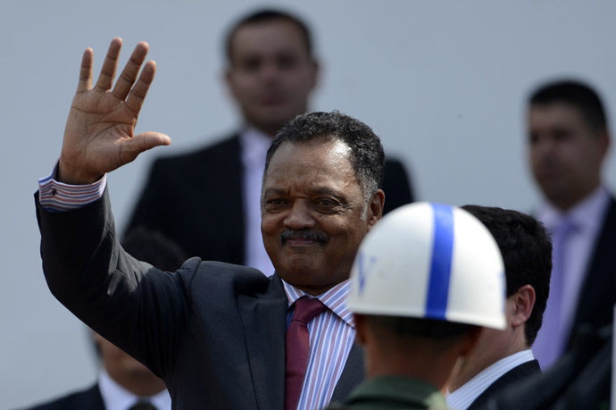 US Reverend Jesse Jackson waves as he arrives to pay his respects to deceased Venezuelan President Hugo Chavez, in Caracas, on March 8, 2013 (AFP Photo/Juan Barreto)