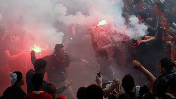 Egyptian al-Ahly football club supporters (Ultras) light flares as they celebrate in Cairo on March 9, 2013 (AFP Photo / Mahmud Khaled)