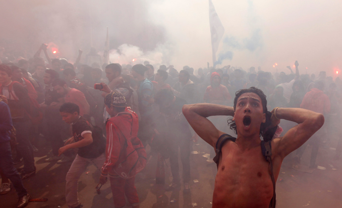 "Al-Ahly fans, also known as ""Ultras"", celebrate and shout slogans in front of the Al-Ahly club after hearing the final verdict of the 2012 Port Said massacre in Cairo March 9, 2013 (Reuters / Amr Abdallah Dalsh)"