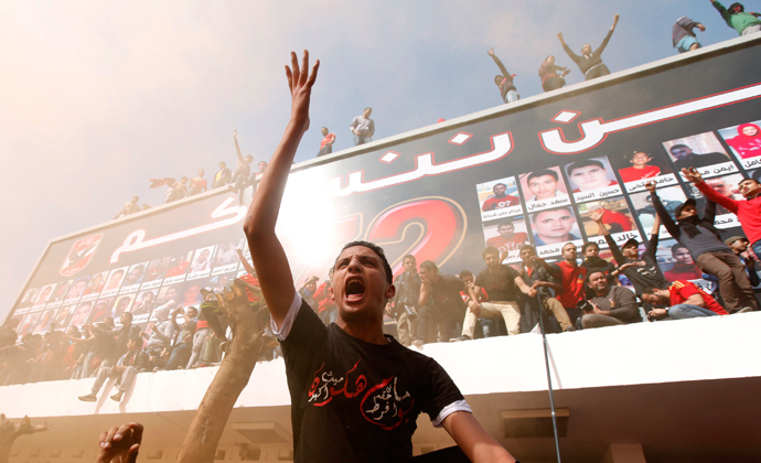 "Al-Ahly fans, also known as ""Ultras"", shout slogans against the Interior Ministry, in front of Al-Ahly club after hearing the final verdict of the 2012 Port Said massacre in Cairo March 9, 2013 (Reuters / Amr Abdallah Dalsh)"