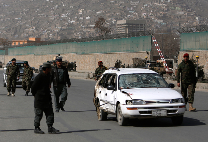 Afghan National Army soldiers remove a damaged car from the site of a suicide attack in Kabul March 9, 2013 (Reuters / Mohammad Ismail)