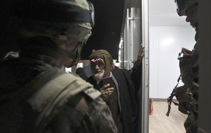 Syrian refugees wait to register their names before they are taken to refugee camps after they crossed the border to Jordan, near Mafraq February 18, 2013. (Reuters/Muhammad Hamed)
