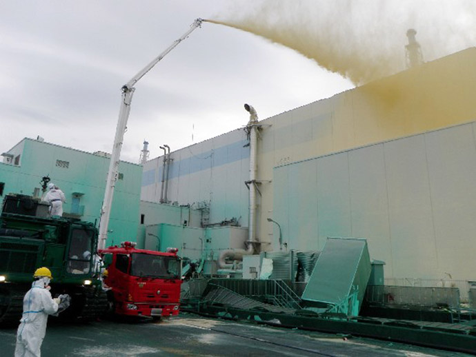 This handout photo taken by Tokyo Electric Power Co (TEPCO) on May 27, 2011 and released on May 29, 2011 shows workers spraying a dust inhibitor into buildings at TEPCO's Fukushima Dai-ichi nuclear power plant at Okuma town in Fukushima prefecture. (AFP Photo/TEPCO)