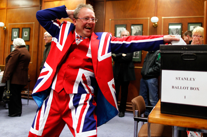 A Falkland Islander gestures as he casts his vote at the Town Hall polling station in Stanley, March 10, 2013 (Reuters / Marcos Brindicci)