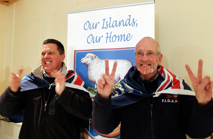 Falkland islanders react after hearing the results of the referendum at the vote counting station in the Town Hall in Stanley, March 11, 2013 (Reuters / Marcos Brindicci)
