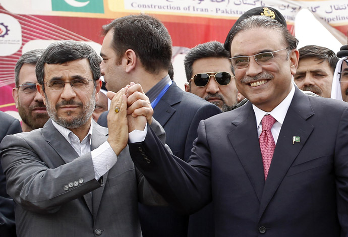Iran's President Mahmoud Ahmadinejad (L) shakes hands with his Pakistani counterpart Asif Ali Zardari during a groundbreaking ceremony to mark the inauguration of the Iran-Pakistan gas pipeline, in the city of Chahbahar in southeastern Iran March 11, 2013. (Reuters/Mian Khursheed)
