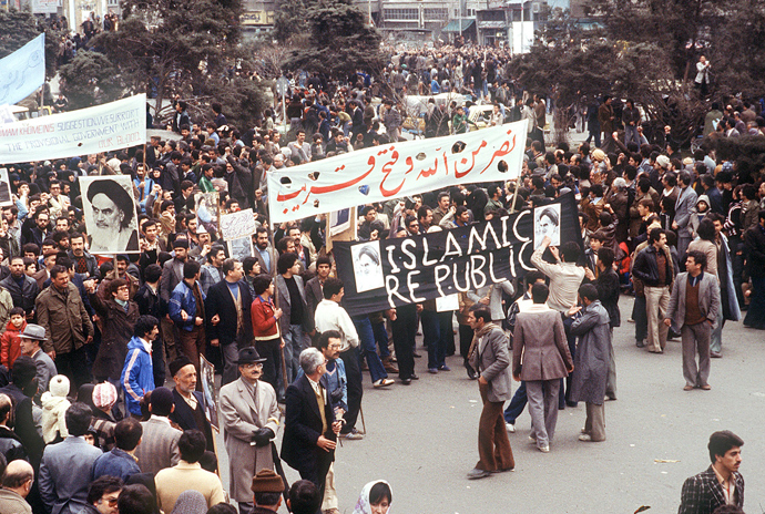 A February 1979 rally in Tehran in support of the National Front government formed on February 14 by Ayatollah Khomeini. The banner with Khomeini's portrait calls for the creation of the Islamic Republic, which will be formed on April 1 of that year. (AFP photo)