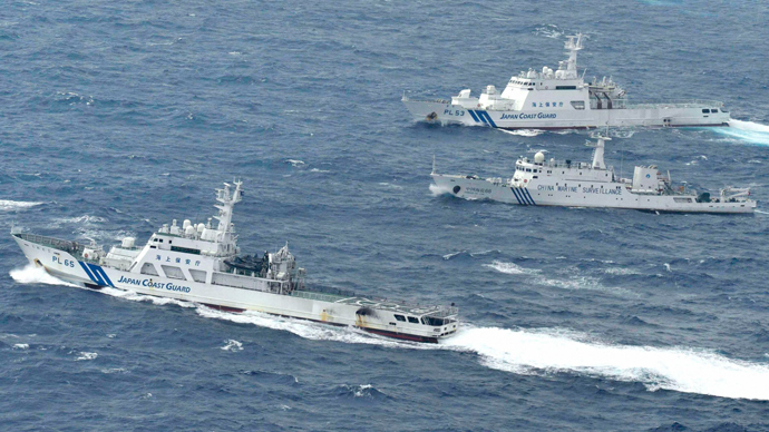 An aerial photo shows a Chinese marine surveillance ship Haijian No. 66 (C) cruising next to Japan Coast Guard patrol ships in the East China Sea, known as Senkaku isles in Japan and Diaoyu islands in China (Reuters / Kyodo)