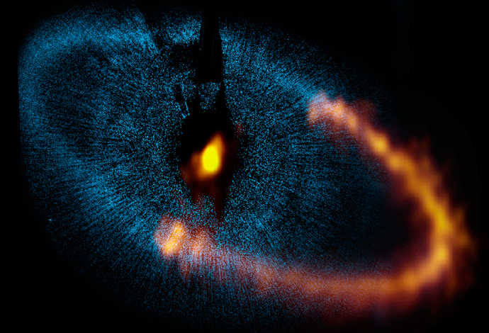 This view shows a new picture of the dust ring around the bright star Fomalhaut obtained by ALMA. The underlying blue picture is an earlier view obtained by the Hubble. Credit: ALMA (ESO/NAOJ/NRAO). Visible light image: the NASA/ESA Hubble Space Telescope