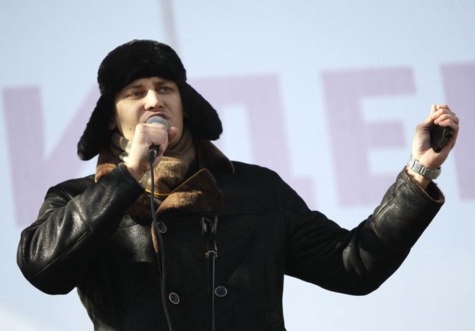"""Dmitry Gudkov speaking at the rally """"For Fair Elections"""" on Novy Arbat street (RIA Novosti / Valeriy Melnikov)"""