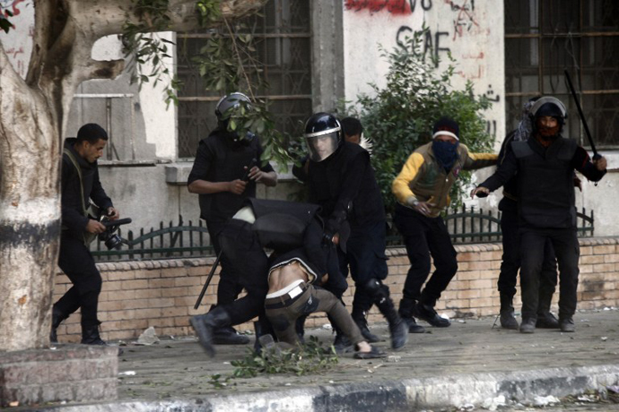 Egyptian riot police detain a man during clashes on Omar Makram street, off Tahrir Square, on November 28, 2012 in Cairo. (AFP Photo / Mahmoud Khaled)