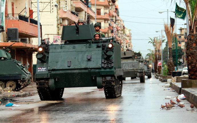 Lebanese Army soldiers patrol the Sunni Muslim Bab al-Tebbaneh neighbourhood in Tripoli, northern Lebanon.(AFP Photo / Omar Ibrahim)