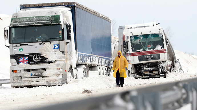 A man walks past a damaged truck at the site of an accident on the E71 motorway, nearby the Croatian, Slovenian and Hungarian borders (AFP Photo / Szilard Gergely)