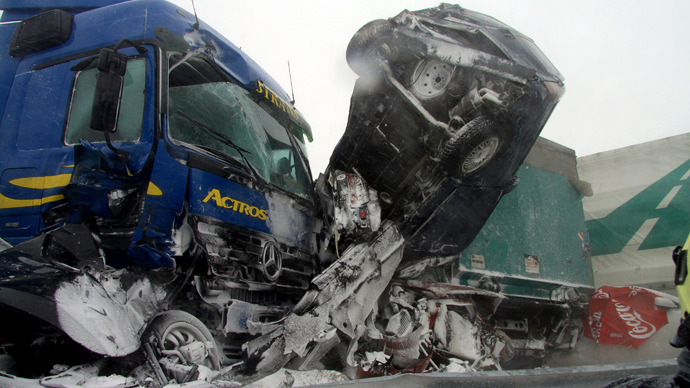A handout photo released by the Hungarian rescuers Katasztrofavedelem shows destroyed cars and trucks stucked after an accident on the E75 motorway, near Szabadbattyan about 70 km west from Hungarian capital Budapest on March 14, 2013 as thirty cars, eight vans and nine trucks collided after a heavy snow storm hit the area (AFP Photo / Katasztrofavedelem)