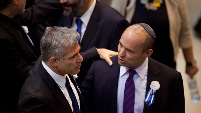Israeli politician Yair Lapid (L), head of Yesh Atid (There is a Future) party embrace Naftali Bennett, head of the Israeli hardline national religious party the Jewish Home (AFP Photo / Uriel Sinal)
