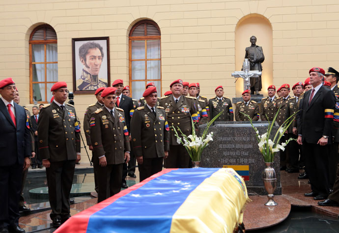 "Handout picture released by the Venezuelan presidency showing members of the presidential Honour Guard surrounding the coffin with the remains of late Venezuelan President Hugo Chavez at a temporary resting place at the former ""4 de Febrero"" barracks -- a barracks-turned-museum that the former paratrooper had used as his headquarters during a failed 1992 coup attempt -- in Caracas, on March 15, 2013.(AFP Photo / Presidencia)"