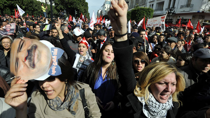 Thousands take to the streets after opposition leader gunned down in Tunisia
