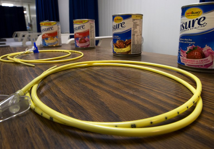 Two feeding tubes and cans of Ensure are seen inside the detainee hospital inside Camp Delta, part of the US Detention Center at Guantanamo Bay, Cuba. (AFP Photo / Paul J. Richards)