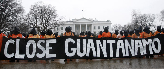 Amnesty International members protest in front of the White House in Washington January 11, 2012. (Reuters)